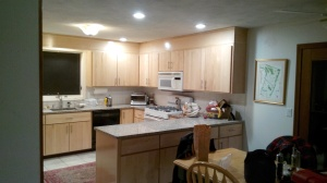 Kitchen upgrade: refaced all cabinets with maple and hung slab doors, installed hardware.